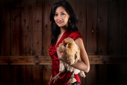 You're holding a chicken?  Seriously?