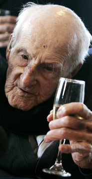 Here he is, looking adorable and drinking a glass of the bubbly on his 113th birthday!